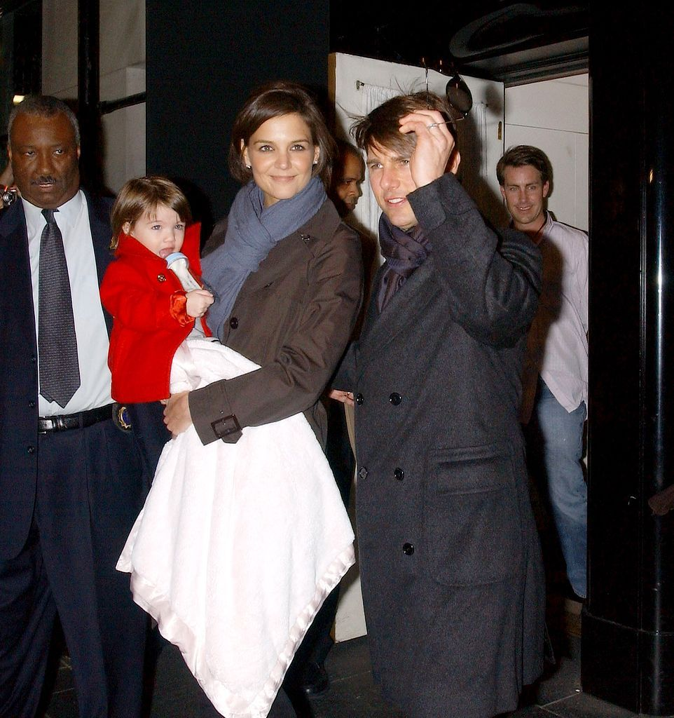 Katie Holmes, Tom Cruise and their daughter Suri leave their hotel on October 20, 2007 in New York City