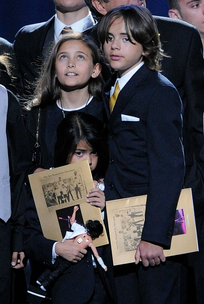 Paris Jackson (L) Prince Michael Jackson I and Prince Michael Jackson II appear onstage during the Michael Jackson public memorial service held at Staples Center on July 7, 2009 in Los Angeles, California
