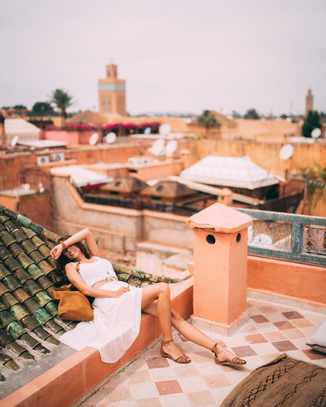 A woman in a white dress lying on a roof