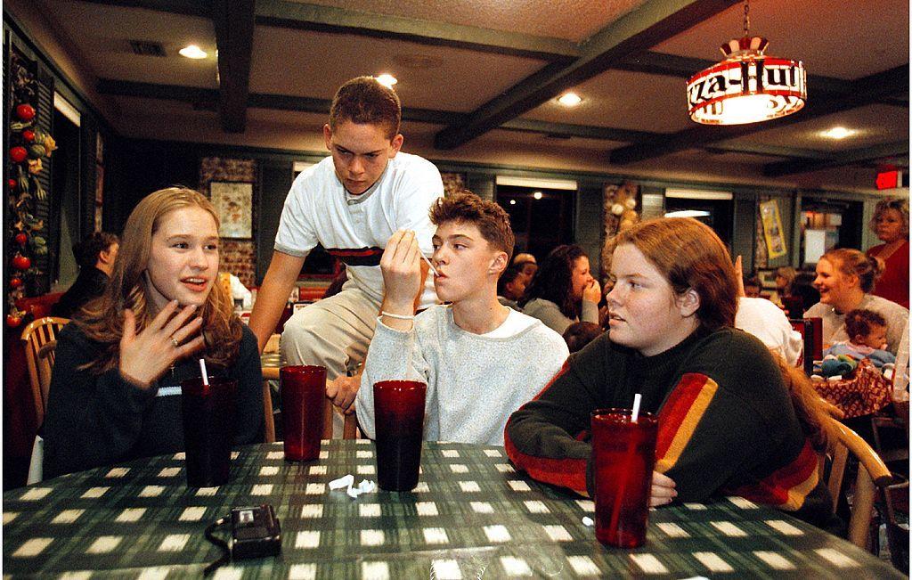 Four children at a '90s Pizza Hut