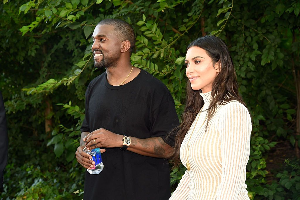 Kanye West together with his wife Kim Kardashian standing outside