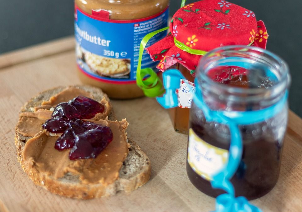 A peanut butter and jelly sandwich in the making