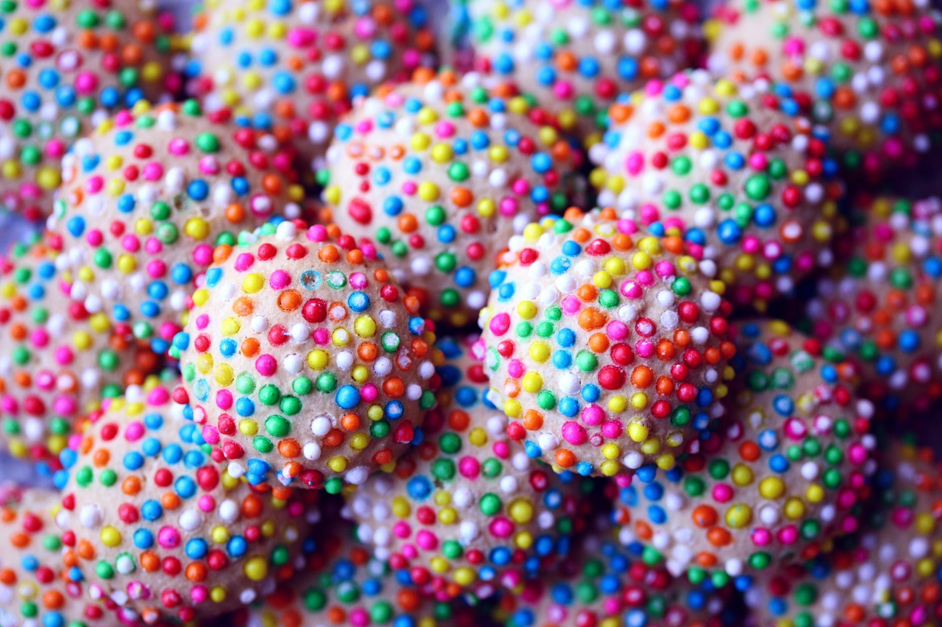 A close up of sprinkle sugar candies