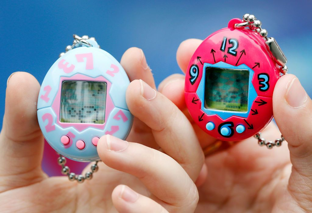 Two Tamagotchi toys being held
