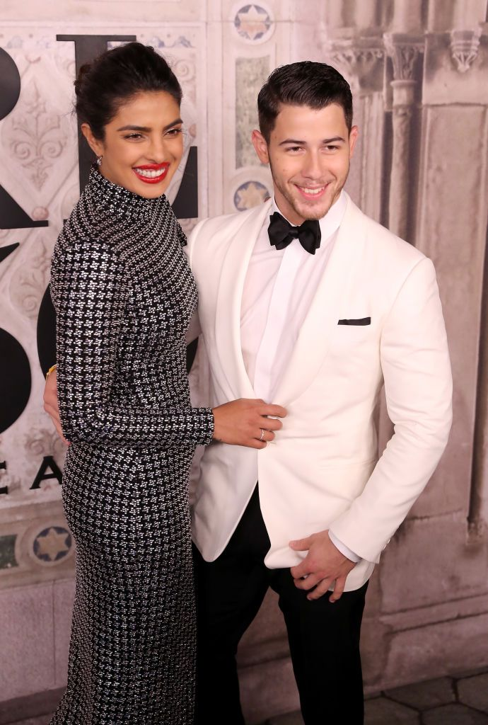 Priyanka Chopra and Nick Jonas attend the Ralph Lauren fashion show during New York Fashion Week at Bethesda Terrace on September 7, 2018 in New York City
