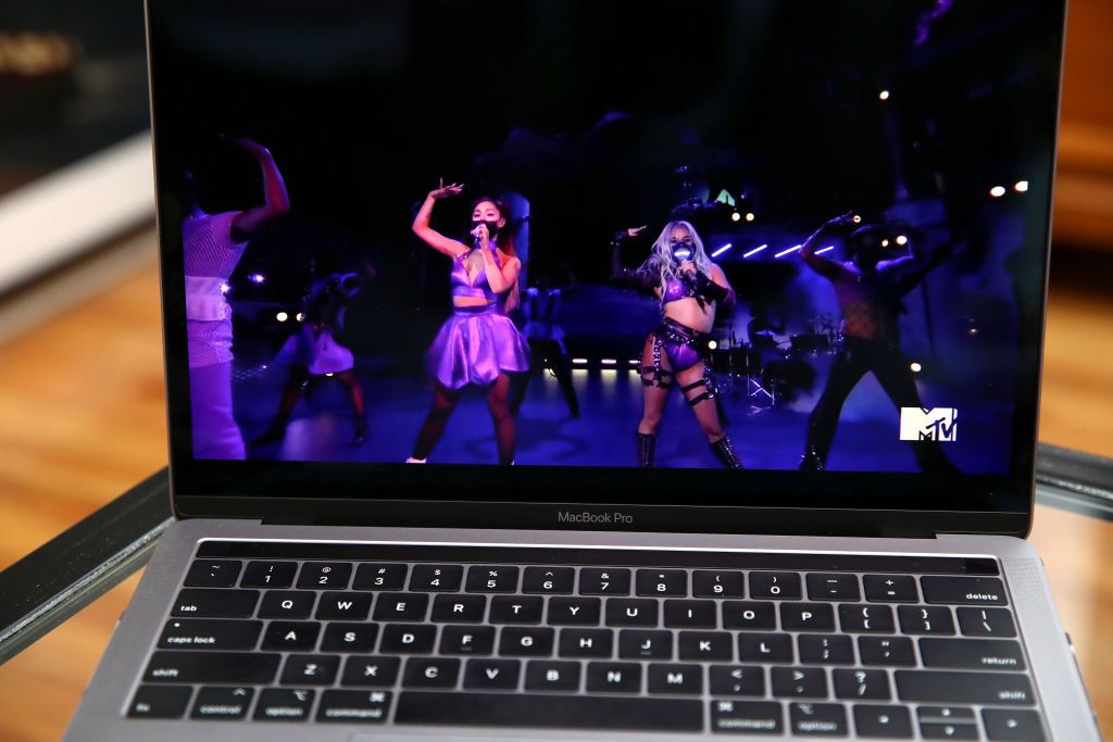 In this photo illustration, Lady Gaga, viewed on a laptop, performs during the 2020 MTV Video Music Awards