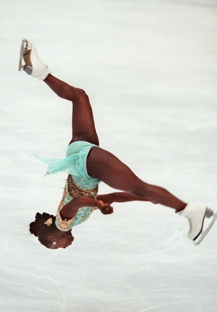 Surya Bonaly of France performs a backflip in her free skate routine in the women's Olympic figure skating
