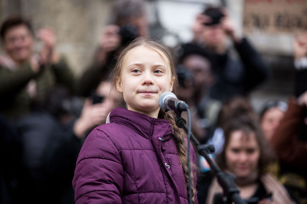 Swedish climate activist Greta Thunberg speaks to participants at a climate change protest