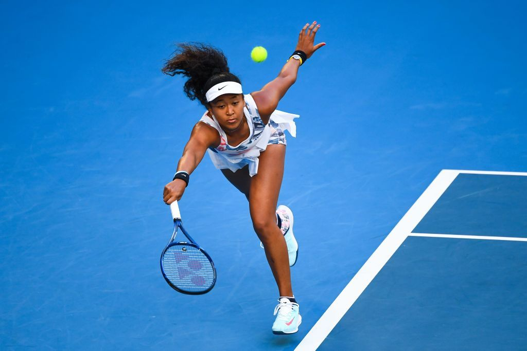 Japan's Naomi Osaka hits a return against Coco Gauff of the US during their women's singles match on day five of the Australian Open tennis tournament