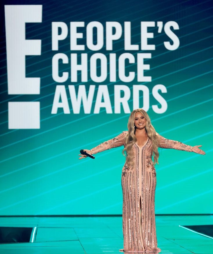November 15, Demi Lovato speaks onstage for the 2020 E! People's Choice Awards held at the Barker Hangar in Santa Monica, California and on broadcast