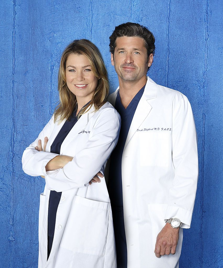 "Walt Disney Television via Getty Images's ""Grey's Anatomy"" stars Ellen Pompeo as Dr. Meredith Grey and Patrick Dempsey as Dr. Derek Shepherd"