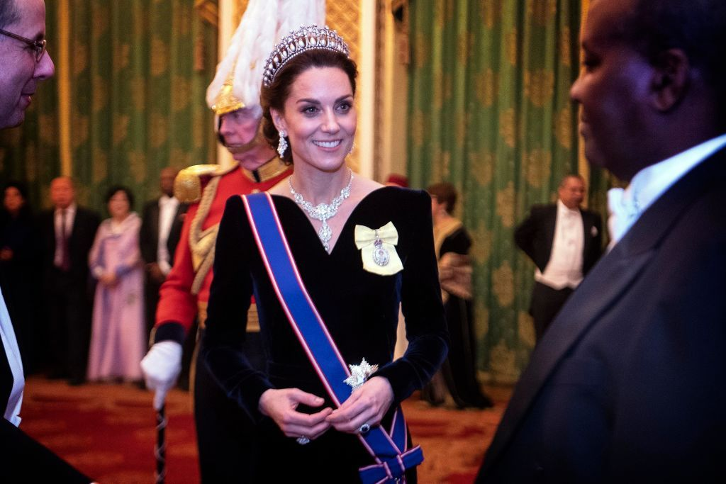 Catherine, Duchess of Cambridge talks to guests at an evening reception for members of the Diplomatic Corps