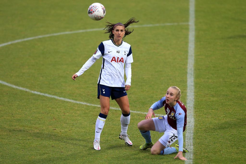 Alex Morgan of Tottenham Hotspur competes for the ball with Caroline Siems of Aston Villa during the Barclays FA Women's Super League match