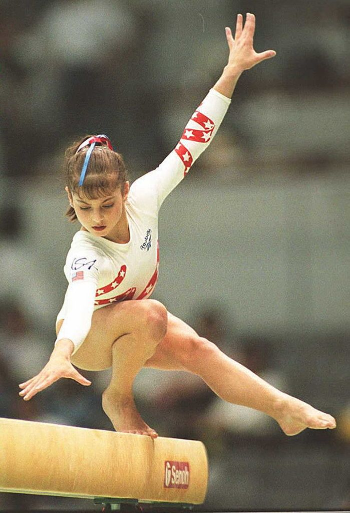 US gymnast Dominique Moceanu performs her routine on the balance beam