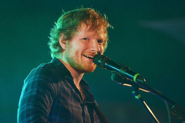 Ed Sheeran performs in green light