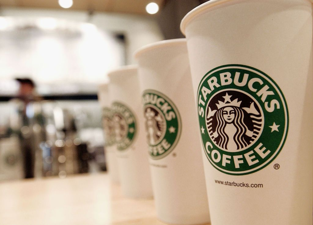 Beverage cups featuring the logo of Starbucks Coffee are seen in the new flagship store on 42nd Street August 2003 in New York City