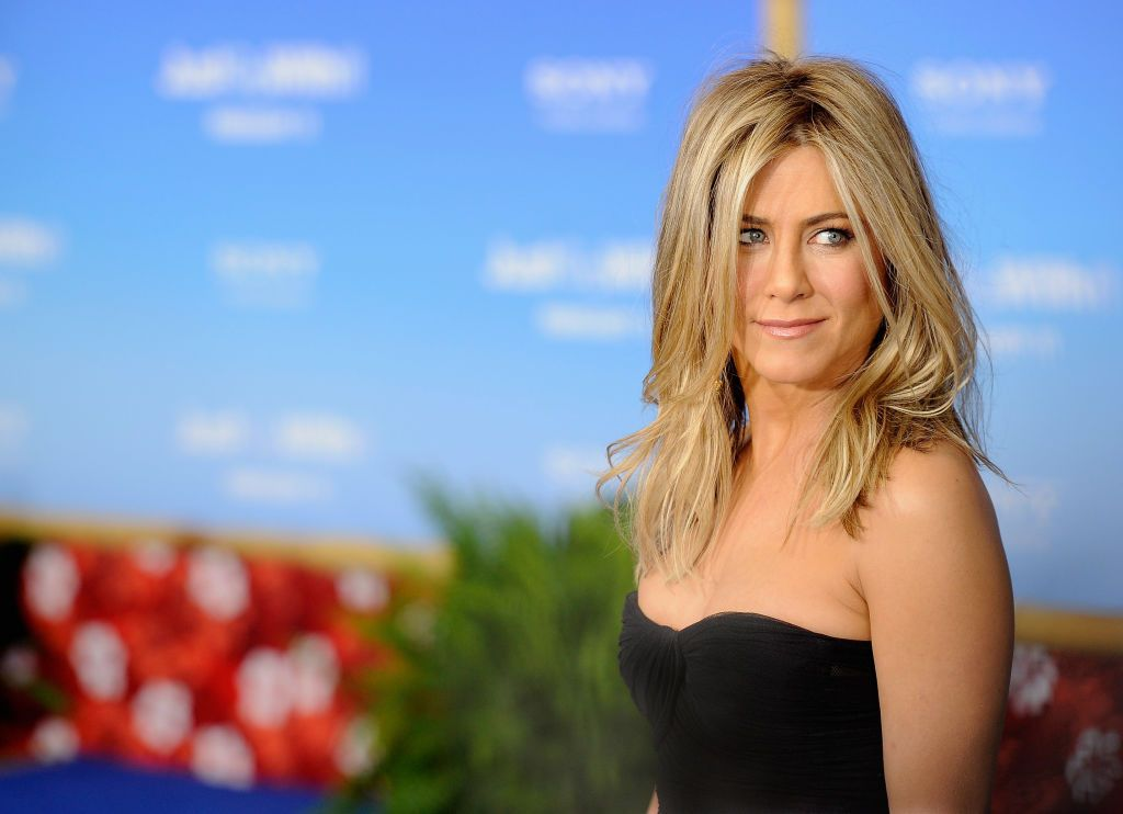 """Actress Jennifer Aniston attends the premiere of """"Just Go With It"""" at Ziegfeld Theatre on February 2011 in New York City"""