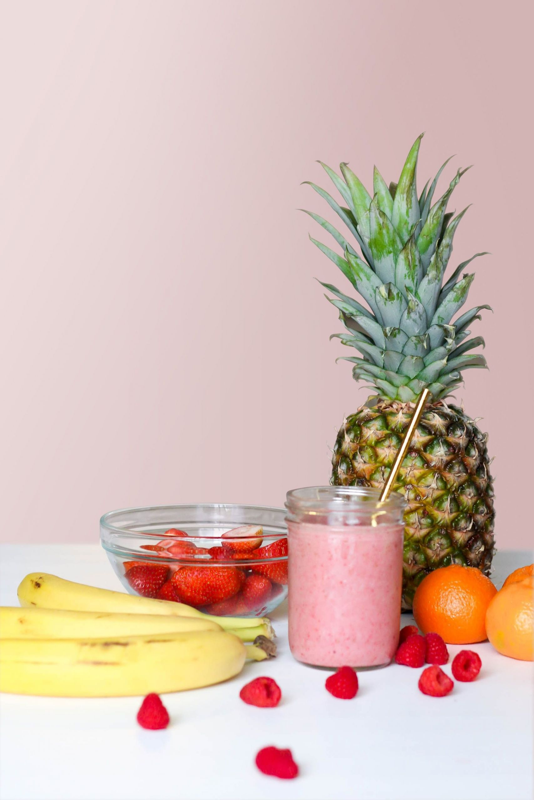 A smoothie pictured with different fruits
