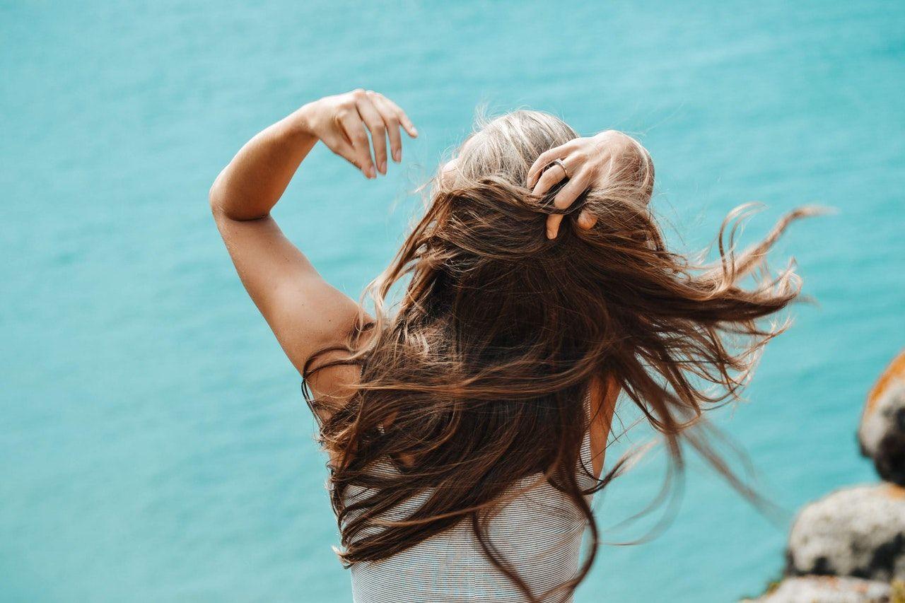 a woman running her hand through her hair